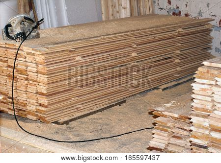 Stack of new wooden studs at the lumber yard, wall paneling