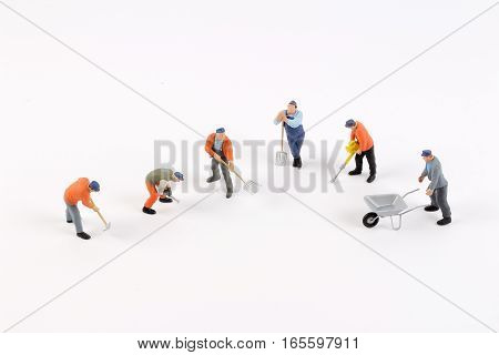 Miniature Workers Isolate On White Background.