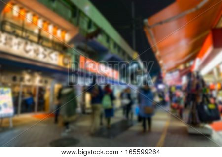 Blurred background . Ameyoko Market in evening.Ameyoko is a busy market street along the Yamanote near Ueno Stations .