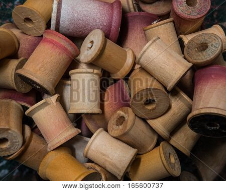 Pile of Antique Wooden Spools Empty of Thread
