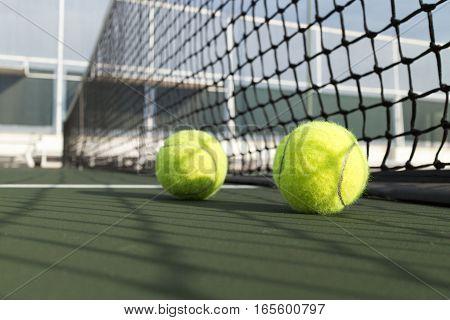 Tennis ball on green tennis hard court