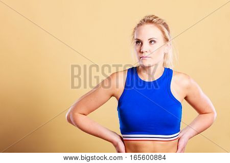 Portrait of sporty fit fitness woman. Attractive girl thinking