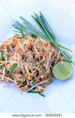 Pad Thai, Stir-fried Rice Noodles With Shrimp In White Dish Isolated On White Background. The One Of