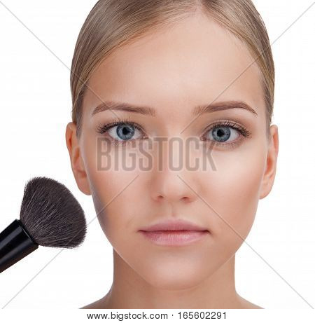 Pretty young woman portrait with makeup brush