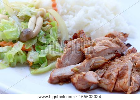 Stir Fried Vegetables And Grilled Chicken Breasts With Thai Jasmine Rice In White Dish Isolated On W