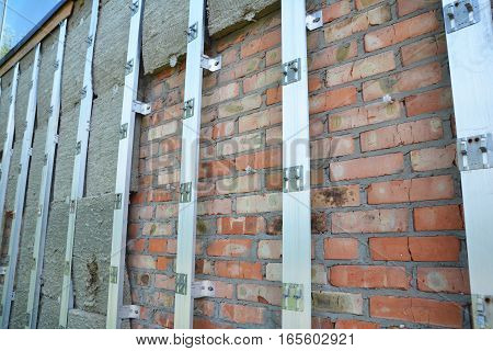 Exterior House Insulation Wall Outdoor. Home Insulation & Reduced Heat Loss Outdoor for Energy Saving.