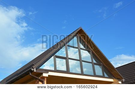 Building house attic conservatory  skylight terrace on the home roof. Conservatory or greenhouse roofing.