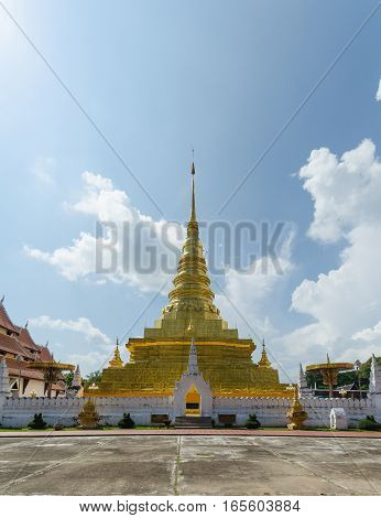 Golden pagoda and blue sky in Phra That Chae Haeng temple nan province thailand