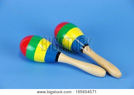 rattle shaker isolated on blue background for design