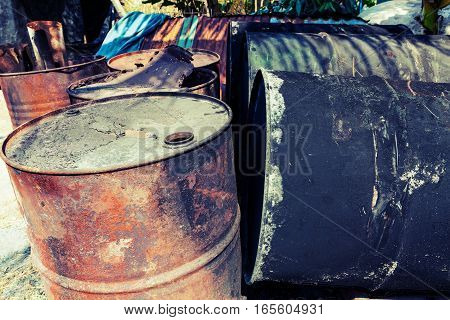 old fuel tanks that lay altogether processed in vintage style