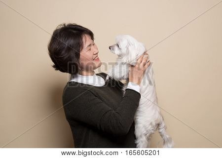 50's Middle-aged Woman and Dog Studio Shot - Isolated