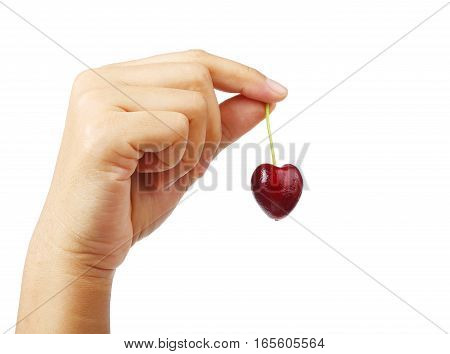 woman hand holding sweet cherry heart shape isolated on white background clipping path.