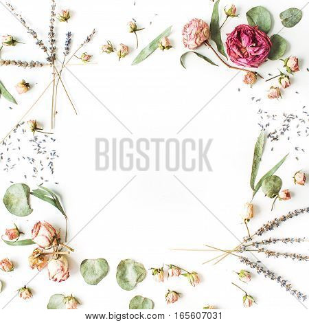 Frame of roses lavender branches leaves and petals on white background. Flat lay top view