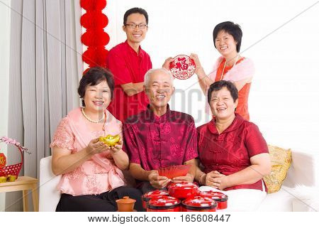 Asian family celebrate chinese new year at home