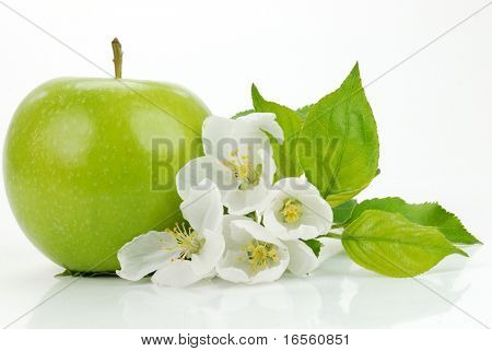Green apple with flowers on the white