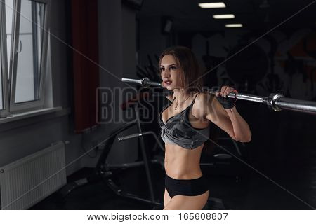 Beautiful Sporty Sexy Woman Doing Squat Workout In Gym.