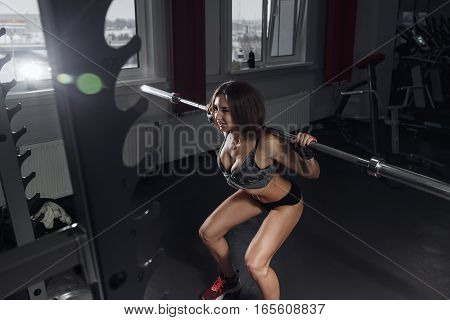 Young Sexy Girl In The Gym Doing Squat.