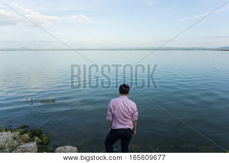river and blue sky with man standing.