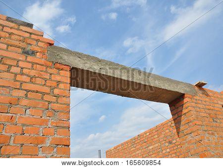 Close up on concrete lintel. Window or door concrete lintel on brick unfinished house construction.
