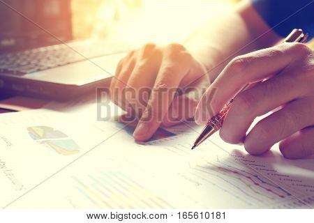 Man Calculate Cost And Expenses And Using Laptop For Search Data Result.