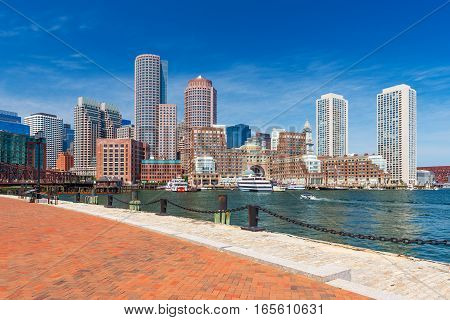 Boston skyline in summer day, skyscrapers in downtown against the blue sky, view from harbor, Massachusetts, USA