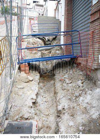 Blue steel gangways over drainage ditch in Alora Street