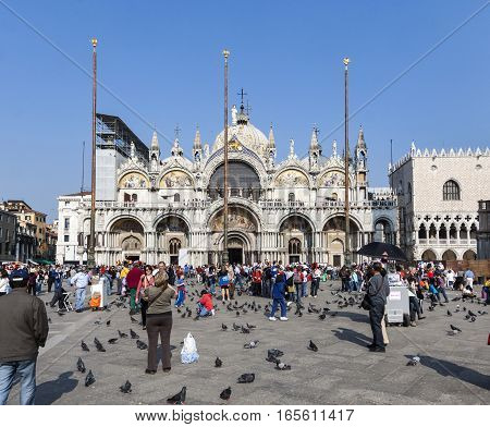 Group Of Young People Pose In Front Of San Marco Church Basilica At San Marco Square In Venice, Ital