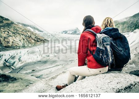 Young Couple Hiking in the Swiss Alps, Taking a Break.