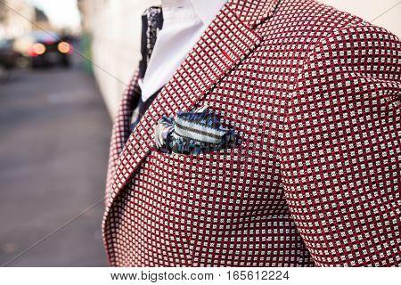MILAN ITALY - JANUARY 16: Detail of a fashionable man outside Etro fashion show building during Milan Men's Fashion Week on JANUARY 16 2017 in Milan.