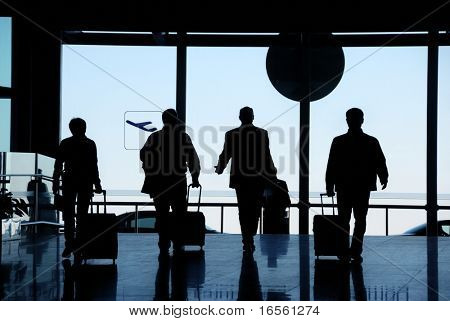 Business travelers silhouette moving in airport