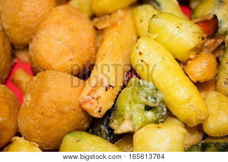 Mix of fried vegetables, potatoes and mozzarella cheese