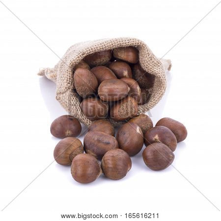 roasted chestnuts in canvas bag on white background