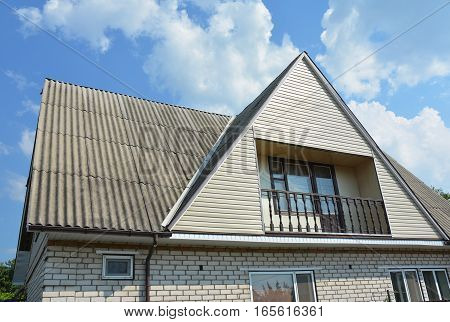 Gable and Valley type of roof construction. Building attic house construction with different types of roof designs