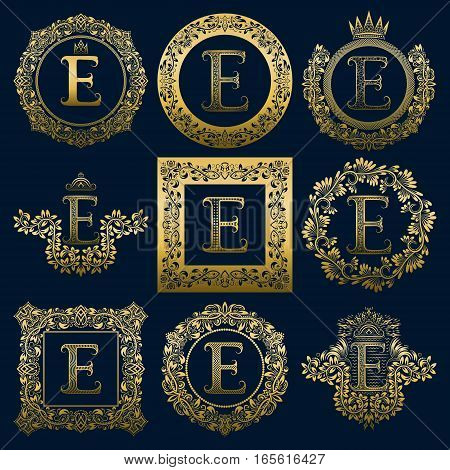 Vintage monograms set of E letter. Golden heraldic logos in wreaths round and square frames.