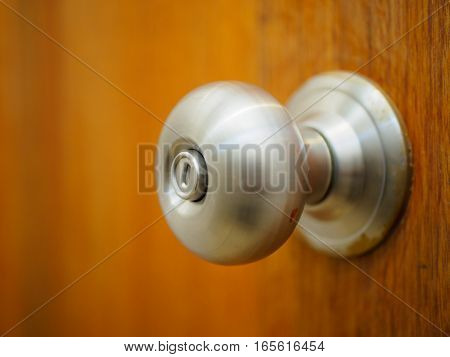 Closeup door knob with wooden door background