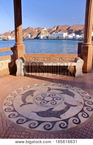 MUSCAT, OMAN: The sidewalk decorated with dolphins in Muttrah