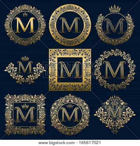 Vintage monograms set of M letter. Golden heraldic logos in wreaths round and square frames.
