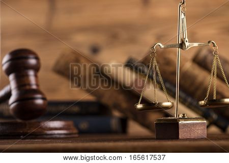 Law and justice concept - gavel of judge, civil code and scale of justice on wooden table