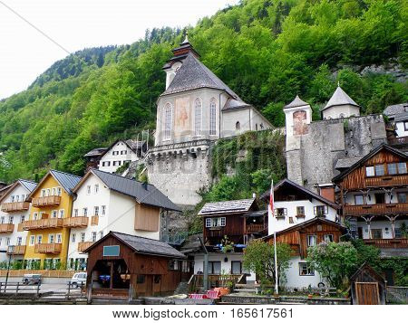 Stunning traditional waterfront house and beautiful church at Hallstatt, Austria, UNESCO World Heritage Site
