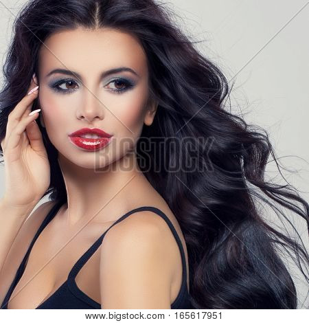 Pretty Woman with Blowing Curly Hairstyle and Makeup. Perfect Face