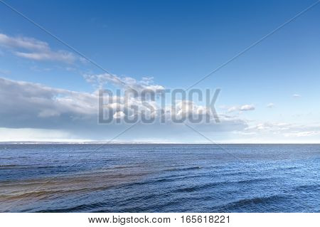 bright Sunny day / cloudy sky over water