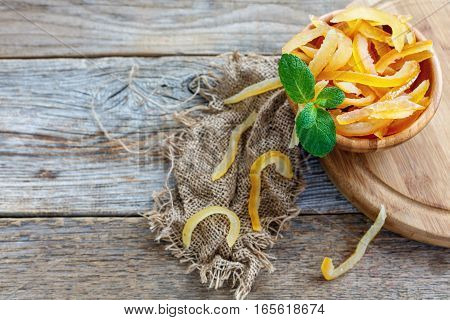Candied Orange Peel And Mint In A Wooden Bowl.