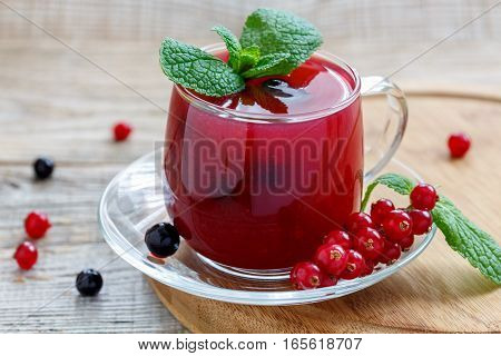 Glass Cup With Pudding Of Red And Black Currants And Sprig Of Mint.