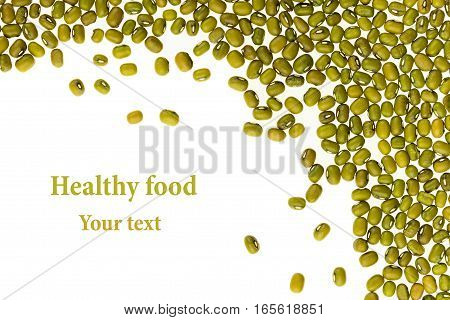Border of mung green beans closeup with copy space on white background. Isolated. Healthy protein food.