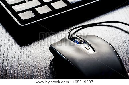 Closeup of keyboard and mouse on black background