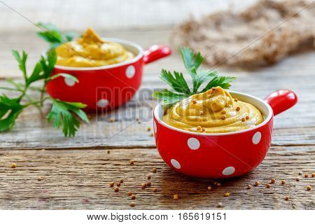 Red Cup With Mustard Sauce And Seeds.