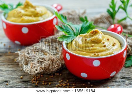 Mustard Sauce And Sprig Of Parsley In A Red Ceramic Bowl.