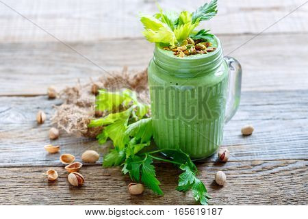 Green Smoothie Spinach, Celery And Bananas In A Glass Jar.