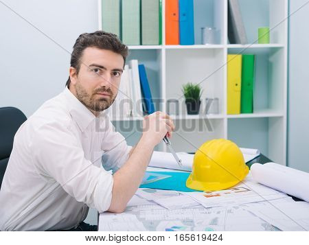 Architect Working On His Projects Papers In The Office