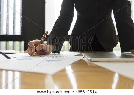 businesswoman in suit analyzing investment charts Accounting and Business concept soft focus vintage tone